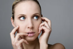 Worried woman looking up stock photography