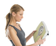 Worried Woman Looking At Weight Scale Royalty Free Stock Images