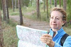 Worried woman lost hiking confused looking at map Royalty Free Stock Images