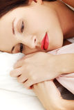 Worried woman lying in bed. Royalty Free Stock Photo