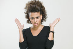 Worried woman making gesture with her hands Stock Images