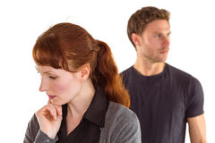 Worried woman with man behind Stock Image