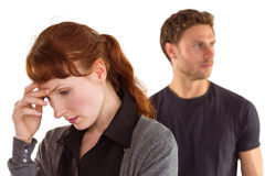 Worried woman with man behind Stock Images