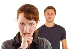 Worried woman with man behind Royalty Free Stock Photo