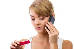 Worried woman with phone informing someone about positive pregnancy test Royalty Free Stock Photography