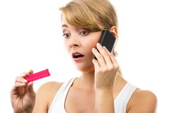 Worried woman with phone informing someone about positive pregnancy test Royalty Free Stock Photo