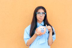 Worried Woman with Piggy Bank thinking what to Invest in Stock Images