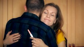 Worried woman with positive pregnancy test hug her man and think stock video footage