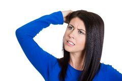 Worried woman scratching head Royalty Free Stock Photo