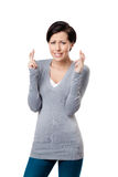 Worried woman shows crossed fingers Stock Photos