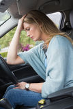 Worried woman sitting in drivers seat Royalty Free Stock Photography