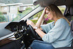 Worried woman sitting in drivers seat Stock Photo