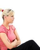 Worried woman sitting on the floor Stock Photography