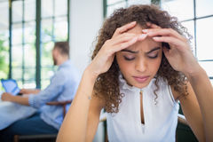 Worried woman sitting in a restaurant Stock Photography