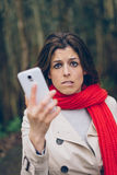Worried woman with smartphone royalty free stock image