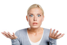 Worried woman spread hands. And doesn't know what to do, isolated on white Royalty Free Stock Photos