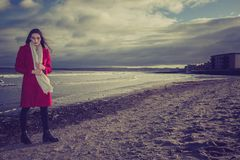 Worried woman on beach. A worried woman standing on a beach at dusk Stock Photography
