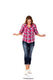 Worried woman standing on weight scale Royalty Free Stock Photography