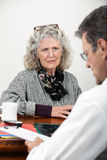Worried Woman Talking with Her Doctor Stock Photos
