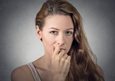 Worried woman thinking looking at you camera. Portrait of worried woman thinking looking at you camera isolated grey wall background. human face expressions Stock Image