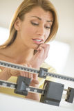 Worried Woman Using Balance Weight Scale Stock Image