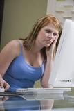 Worried Woman Using Computer Stock Photography