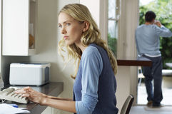 Worried Woman Using Computer Royalty Free Stock Image