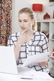 Worried Woman Using Laptop And Reviewing Domestic Finances Royalty Free Stock Image