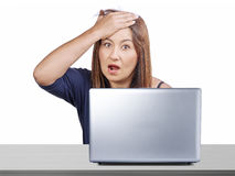Worried woman working desk laptop forgotten something regret mistake isolated Royalty Free Stock Image