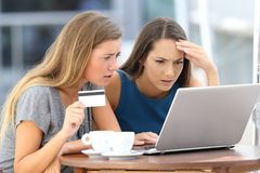 Worried women having problem buying on line Stock Image