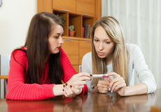 Worried women with pregnancy test Stock Images