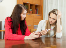 Worried women with pregnancy test Royalty Free Stock Photography