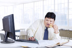 Worried worker looking at monitor Royalty Free Stock Image
