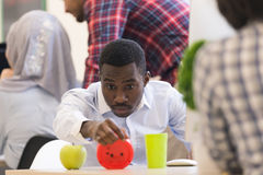 Worried young African man in formalwear checking time while look. Ing at his watch Stock Photography