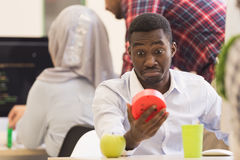 Worried young African man in formalwear checking time while look. Ing at his watch Royalty Free Stock Image