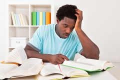 Worried young african man studying Royalty Free Stock Image