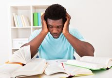 Worried young african man studying Stock Photo