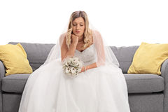 Worried young bride sitting on a sofa Royalty Free Stock Image