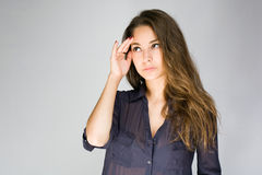 Worried young brunette woman. Royalty Free Stock Photo