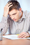 Worried young business man Stock Photography