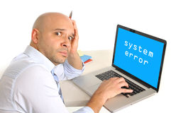 Worried young business man technical problem at computer Royalty Free Stock Photography