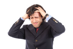 Worried young businessman pulling the hair. Isolated on white background stock image