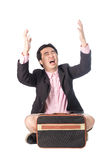 Worried young businessman sitting and screaming, isolated on whi Royalty Free Stock Photos