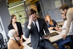 Free Worried Young Businessman Using Digital Tablet In Office Stock Images - 172252454