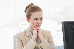 Worried young businesswoman looking at computer Royalty Free Stock Image