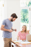 Worried young couple discussing on bills Royalty Free Stock Photography