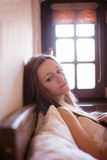 Worried Young Girl Lying In Bed Royalty Free Stock Photo