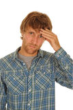 Worried young man. Half body portrait of worried young man in check shirt; isolated on white background stock photo