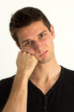 Worried young man. With hand on face Royalty Free Stock Photo
