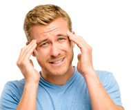 Worried young man suffering from headache Stock Photos